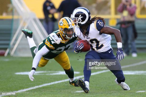 Los Angeles Rams wide receiver Shakeir Ryan is chased down by Green Bay Packers safety Josh Jones during a game between the Green Bay Packers and the...