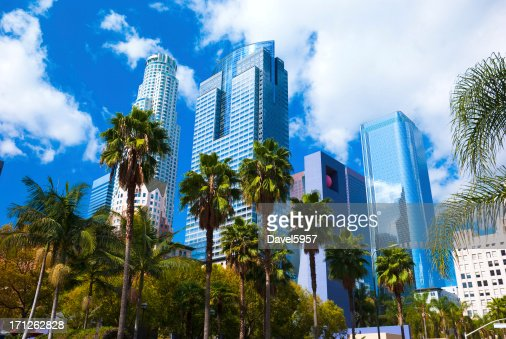 Los Angeles skyscrapers, clouds, and palm trees