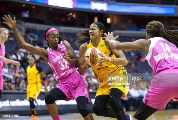 Los Angeles Sparks forward Candace Parker bursts between Washington Mystics guard Shatori WalkerKimbrough and guard Tierra RuffinPratt during a WNBA...