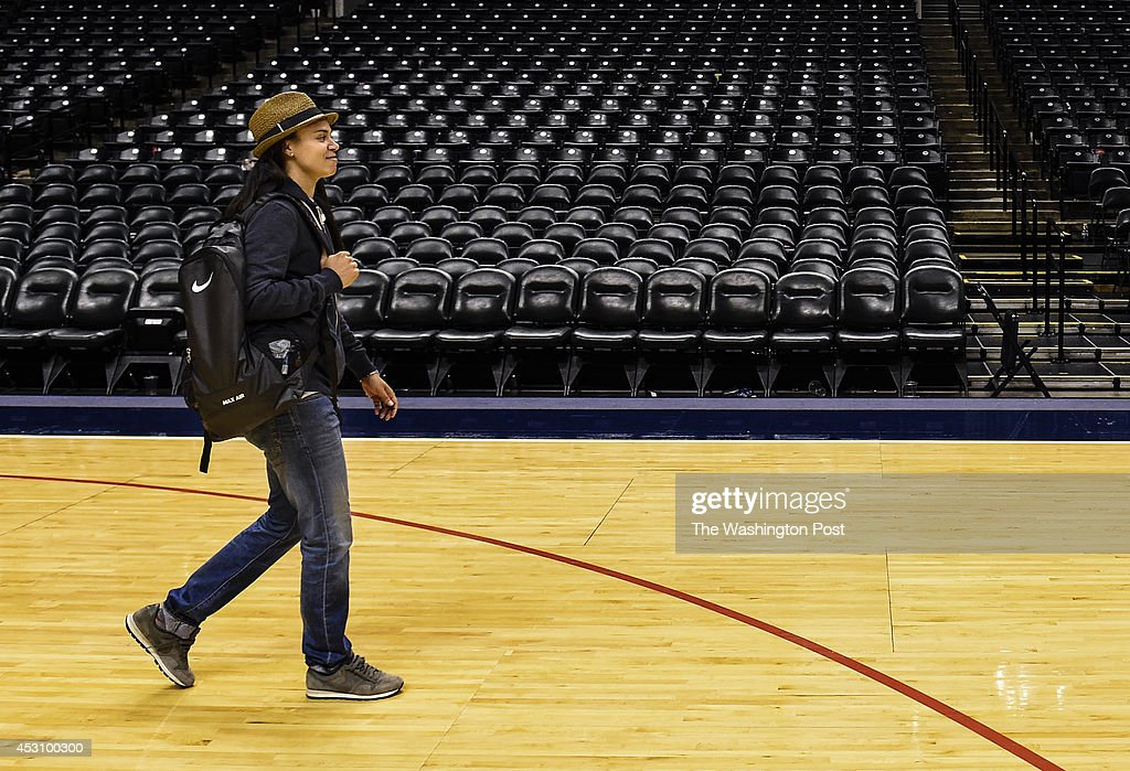 Los Angeles Sparks guard Kristi Toliver a former University of Maryland player walks across the court in an empty arena after playing a game against...