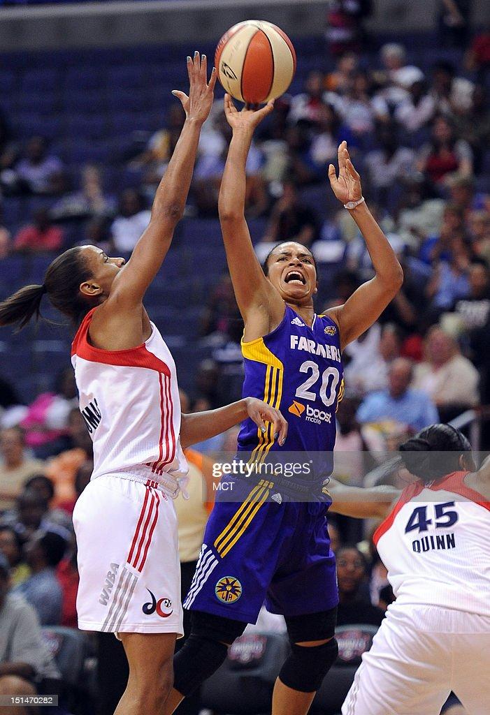 Los Angeles Sparks guard Kristi Toliver (20) draws a shooting foul on Washington Mystics guard Jasmine Thomas (5) in the first quarter at the Verizon Center in Washington, D.C., Friday, September 7, 2012,