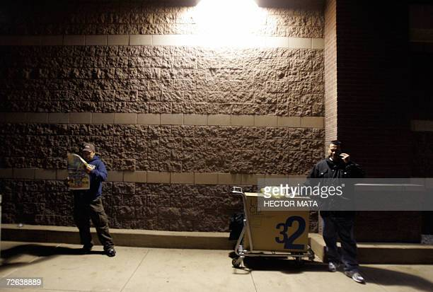 A customer speaks on the phone after buying a flat screen television in an electronic supplies store in Los Angeles 24 November 2006 According to the...