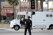 A Los Angeles police officer directs traffic at a fiveway intersection in the North Hollywood section of the City of Los Angeles California after a...