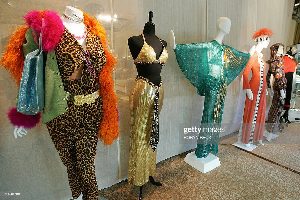 Costumes designed for Cher by Bob Mackie are on display 29 September 2006 at a public auction preview at a Los Angeles hotel. Sotheby's will auction off furniture, clothing, jewelry, art, books and more from Cher's 16,000-square-foot Malibu Italian Renaissance mansion on 03-04 October in Los Angeles. Cher told the Los Angeles Times that she is selling off much of the contents of the home so you she can redecorate in Tibetan, Moroccan, Indian and Zen style. AFP PHOTO / Robyn BECK