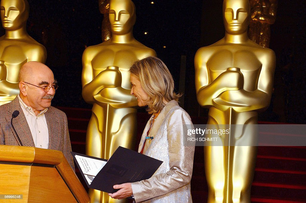 Director Cristina Comencini of 'Don't Tell' receives her official Academy Award Nomination from film editor Alan Heim during a reception with the...