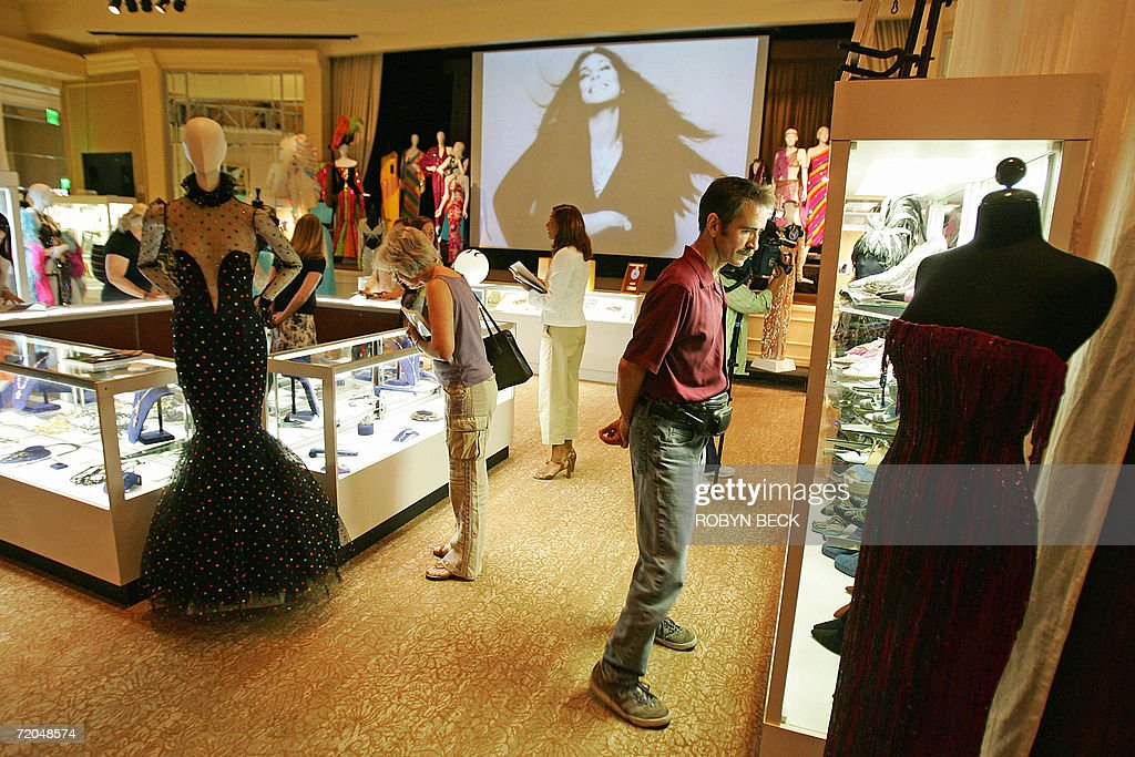 People view belongings of singer Cher at a public auction preview 29 September 2006 in Los Angeles. Sotheby's will auction off furniture, clothing, jewelry, art, books and more from Cher's 16,000-square-foot (1,486 sq.-meter) Malibu Italian Renaissance mansion on 03-04 October in Los Angeles. Cher told the Los Angeles Times that she is selling off much of the contents of the home so you she can redecorate in Tibetan, Moroccan, Indian and Zen style. AFP PHOTO/Robyn BECK
