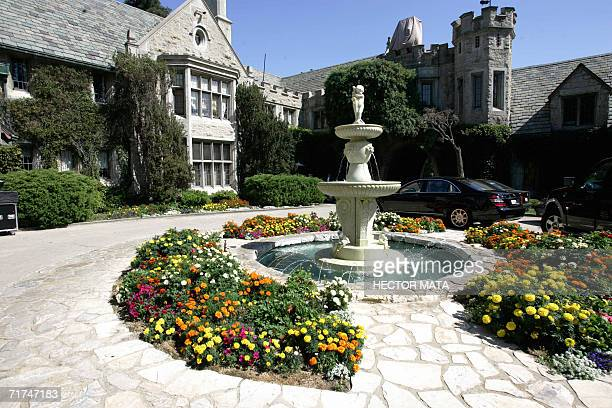 The entrance of Playboy Enterprises CEO Hugh Hefner's mansion is shown in Los Angeles California 23 August 2006 Hefner called journalists to promote...