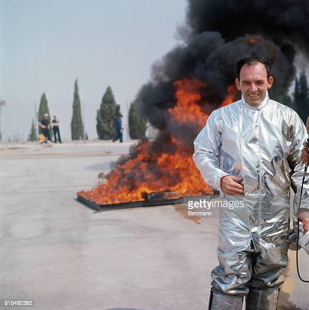 Los Angelos California test engineer John Hand walks through a pit of flaming gasoline to demonstrate a heat resistant suit that can be used for...