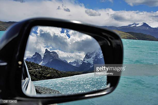 Los Cuernos and Lago Pehoè. Majestic snowcapped mountains, 'the Horns'and Lake Pehoè, reflected in car mirror. Torres del Paine National Park, Chile