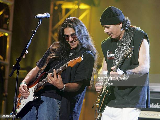 Los Lonely Boys with musician Henry Garza and musician Carlos Santana perform at rehearsals for the 2005 American Music Awards at the Shrine...