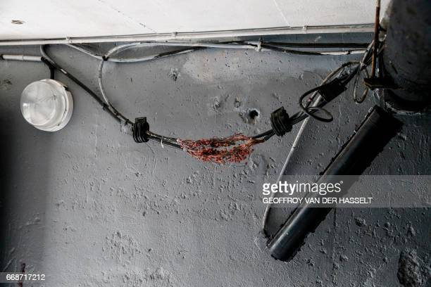 Lose electricity cables are seen in the cellar of an HLM building that is part of the HLM housing estate of AulnaysousBois a commune in the...