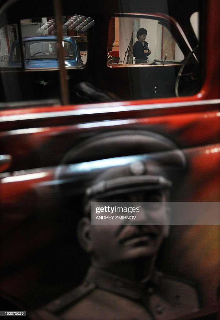 A lose view of a GAZ-M20 'Pobeda' car bearing a portrait of Soviet dictator Josef Stalin displayed at the Museum of the Soviet Union in Moscow on March 4, 2013. The museum displays an exhibition of objects reflecting all aspects of life in the Soviet State, the museum officials said.