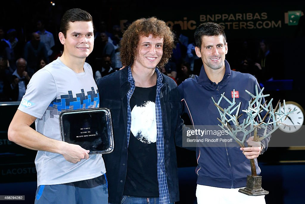 Loser of the final <a gi-track='captionPersonalityLinkClicked' href=/galleries/search?phrase=Milos+Raonic&family=editorial&specificpeople=5421226 ng-click='$event.stopPropagation()'>Milos Raonic</a>, Football player <a gi-track='captionPersonalityLinkClicked' href=/galleries/search?phrase=David+Luiz&family=editorial&specificpeople=4133397 ng-click='$event.stopPropagation()'>David Luiz</a> and winner of the tournament <a gi-track='captionPersonalityLinkClicked' href=/galleries/search?phrase=Novak+Djokovic&family=editorial&specificpeople=588315 ng-click='$event.stopPropagation()'>Novak Djokovic</a> attend the Final match during day 7 of the BNP Paribas Masters. Held at Palais Omnisports de Bercy on November 2, 2014 in Paris, France.