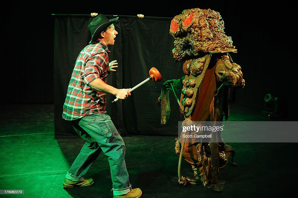 Lost Boys Productions perform an excerpt of their show The Revenge of the Gargantuan Poo Monster during the Greenside Press Launch at Day 1 of The Edinburgh Festival Fringe on July 31, 2013 in Edinburgh, Scotland.