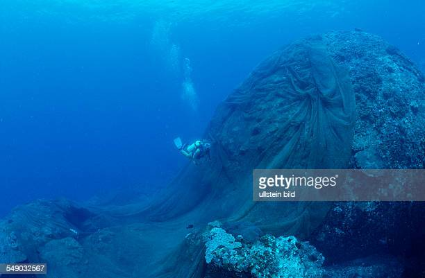 Lost fishnet over coral reef Malaysia South Chinese Sea
