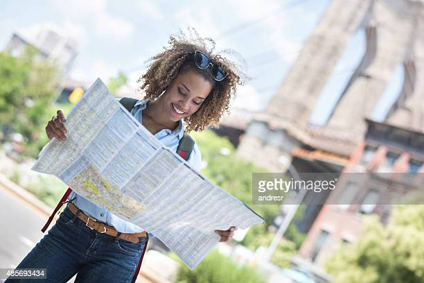 Lost tourist in New York City holding a map