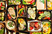 A lot of cardboard boxes with delicious and healthy food