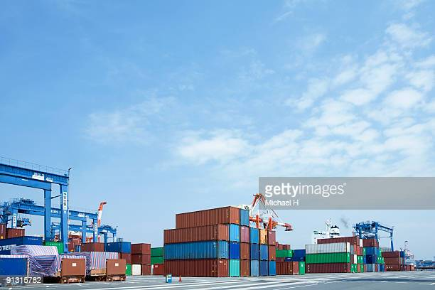 A lot of colorful containers put on port