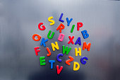 Colorful letters on a silver ground