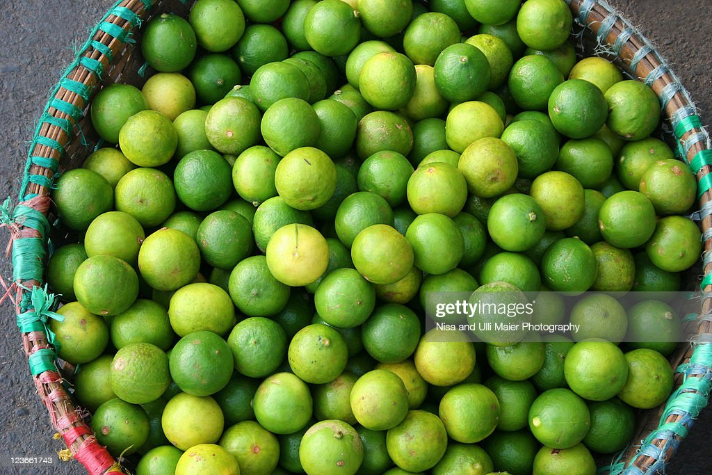 Lot of limes at market in Malaysia. : Stock Photo