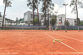 Tremendous recreation center. Many small tennis balls are locating at covering of special arena. Copy space on left side