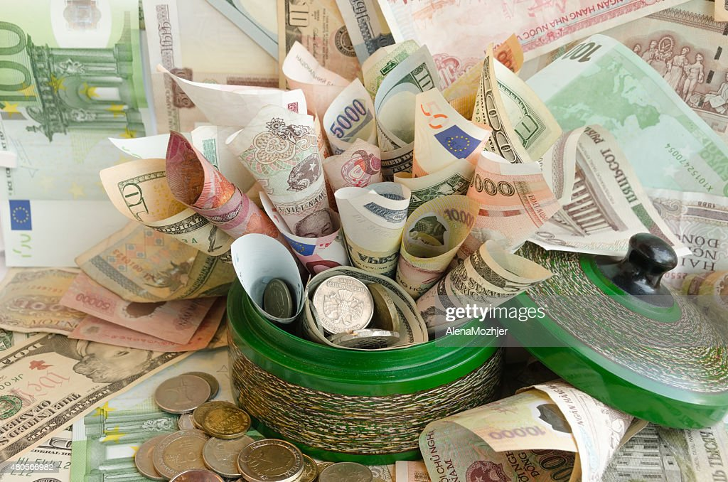 lot of money in green money box : Stock Photo