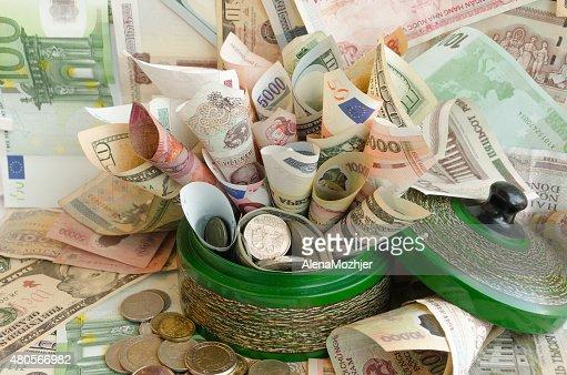 lot of money in green money box : Stock Photo