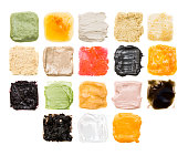 A lot of samples of different textures of cosmetics on white background