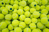Lot of virant tennis balls for sport background