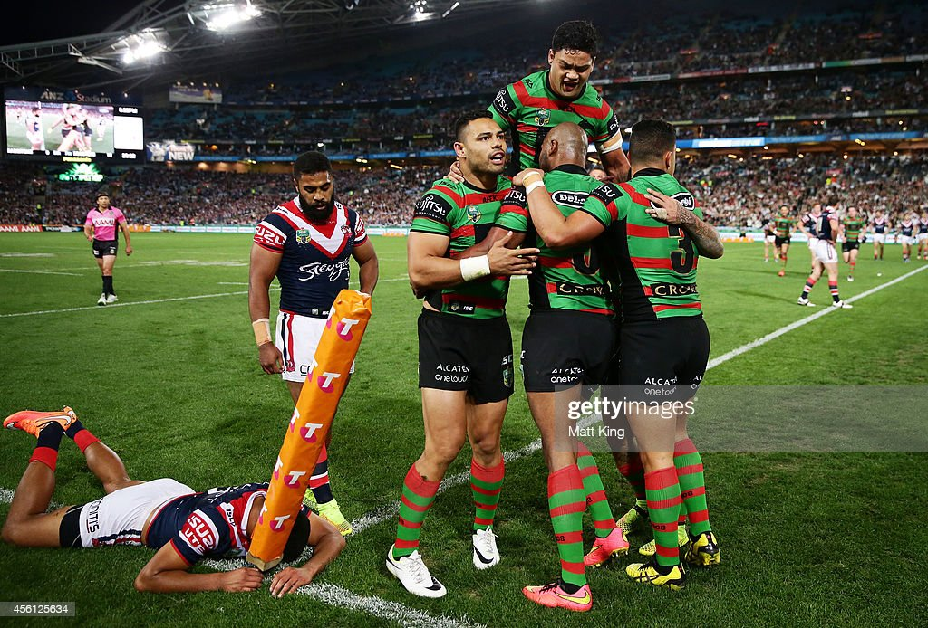Lote Tuqiri (C) of the Rabbitohs celebrates with team mates after scoring a try during the First Preliminary Final match between the South Sydney Rabbitohs and the Sydney Roosters at ANZ Stadium on September 26, 2014 in Sydney, Australia.