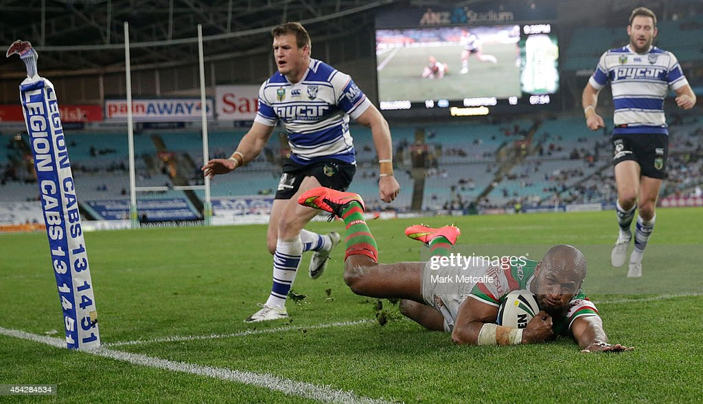 Lote Tuqiri of the Rabbitohs scores a try during the round 25 NRL match between the Canterbury Bulldogs and the South Sydney Rabbitohs at ANZ Stadium on August 28, 2014 in Sydney, Australia.