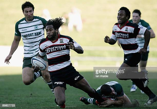 Lote Tuqiri of West Harbour is tackled during the round 20 Shute Shield match between Warringah and West Harbouron at Pittwater Rugby Park on August...