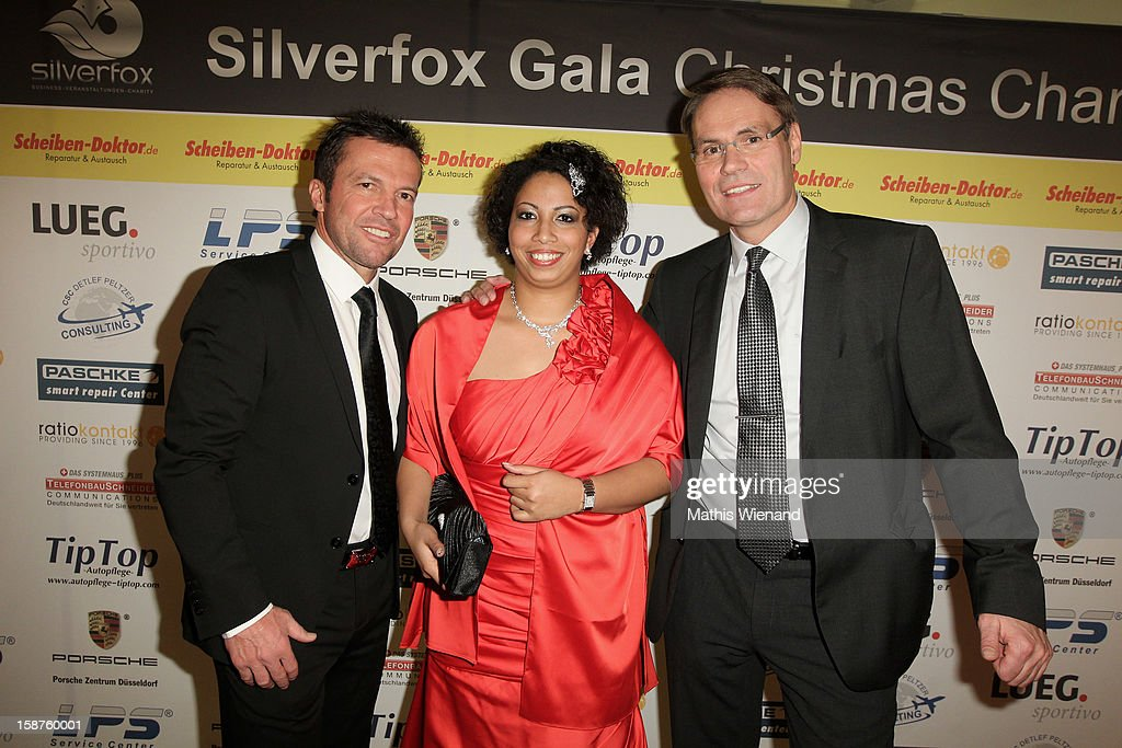 Lothar Matthaeus with Eventmanager Jennifer Peltzer and Detlef Peltzer attends the Silver Fox Charity Gala at Hotel van der Falk on December 22, 2012 in Moers, Germany.