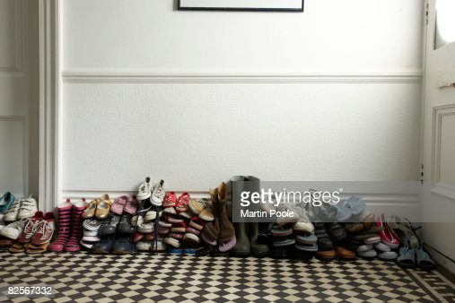 lots of different shoes stacked in hallway : Stock Photo