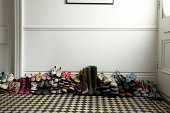 lots of different shoes stacked in hallway