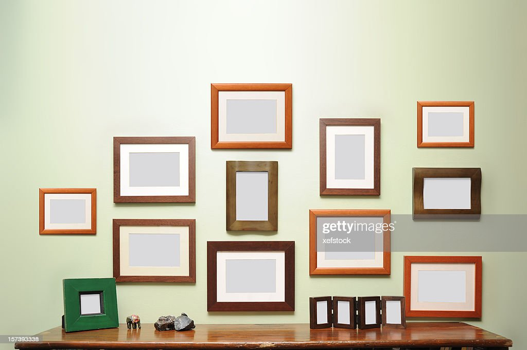 lots of frames on the wall