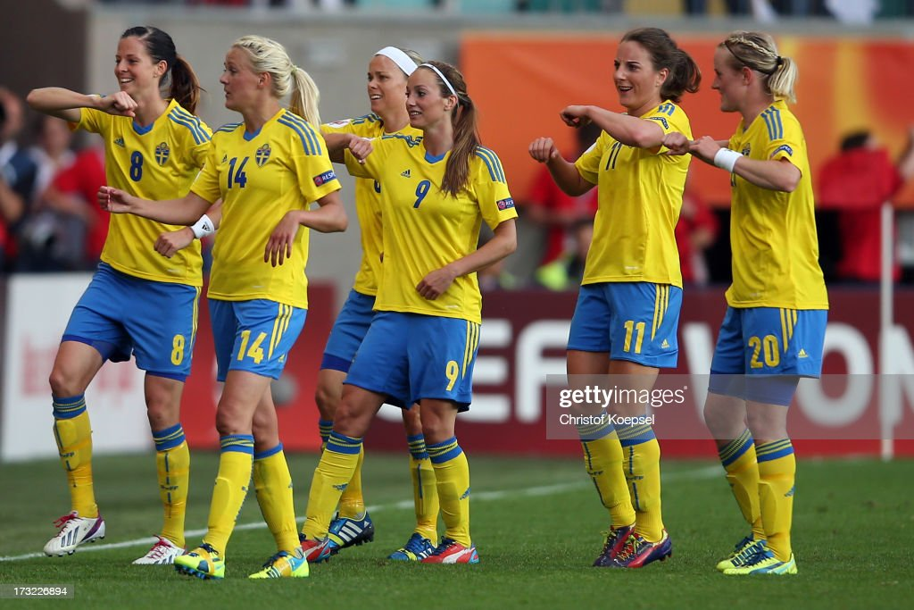 <a gi-track='captionPersonalityLinkClicked' href=/galleries/search?phrase=Lotta+Schelin&family=editorial&specificpeople=742197 ng-click='$event.stopPropagation()'>Lotta Schelin</a>, Josefine Oeqvist, <a gi-track='captionPersonalityLinkClicked' href=/galleries/search?phrase=Nilla+Fischer&family=editorial&specificpeople=2398003 ng-click='$event.stopPropagation()'>Nilla Fischer</a>, <a gi-track='captionPersonalityLinkClicked' href=/galleries/search?phrase=Kosovare+Asllani&family=editorial&specificpeople=6176342 ng-click='$event.stopPropagation()'>Kosovare Asllani</a>, Antonia Goeransson and Marie Hammarstroem of Sweden celebrate the first goal of Sweden during the UEFA Women's EURO 2013 Group A match between Sweden and Denmark at Gamla Ullevi Stadium on July 10, 2013 in Gothenburg, Sweden.