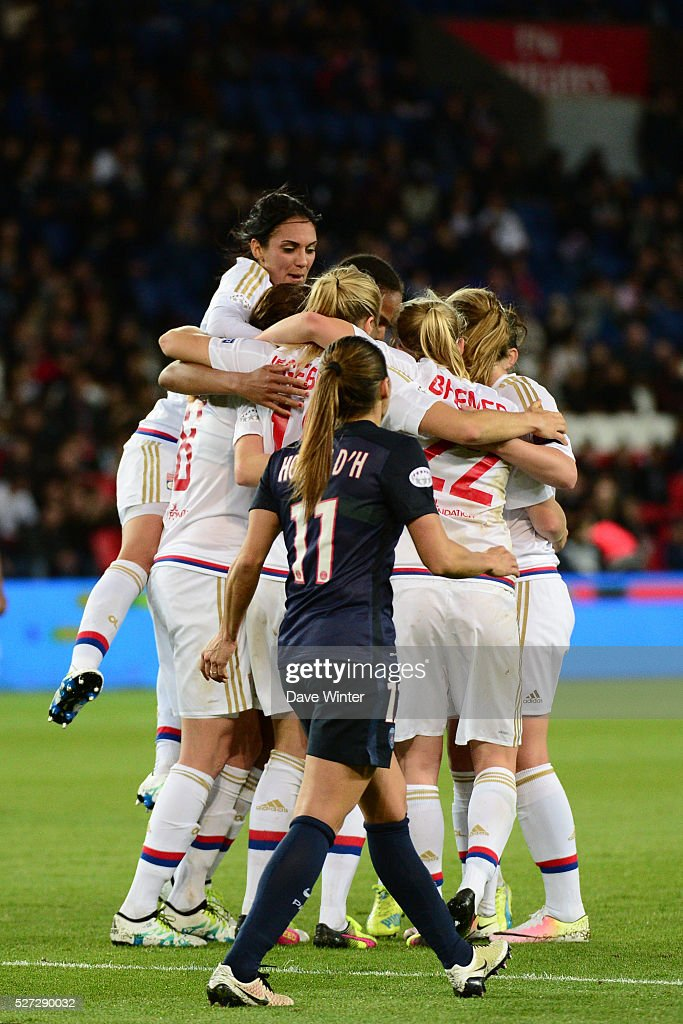 Lotta Schelin of Lyon celebrates opening the scoring with team mates, as Jessica Houara DHommeaux of PSG looks on,during the Uefa Women's Champions League match, semi-final, second leg, between Paris Saint Germain and Olympique Lyonnais at Parc des Princes on May 2, 2016 in Paris, France.