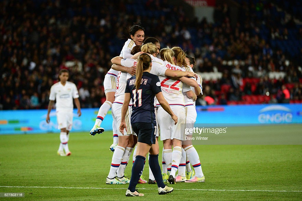 Lotta Schelin of Lyon celebrates opening the scoring with team mates, as Jessica Houara DHommeaux of PSG looks on, during the Uefa Women's Champions League match, semi-final, second leg, between Paris Saint Germain and Olympique Lyonnais at Parc des Princes on May 2, 2016 in Paris, France.
