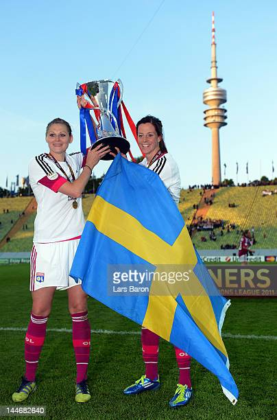 Lotta Schelin of Olympique Lyonnais celebrates with team mate Corine Franco after winning the UEFA Women's Champions League Final at Olympiastadion...