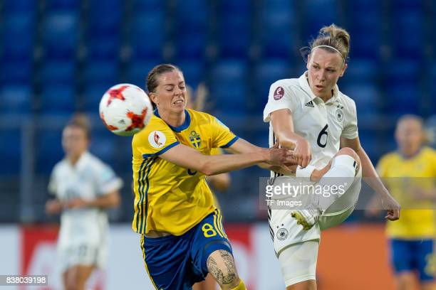Lotta Schelin of Sweden and Kristin Demann of Germany battle for the ball l during the Group B match between Germany and Sweden during the UEFA...