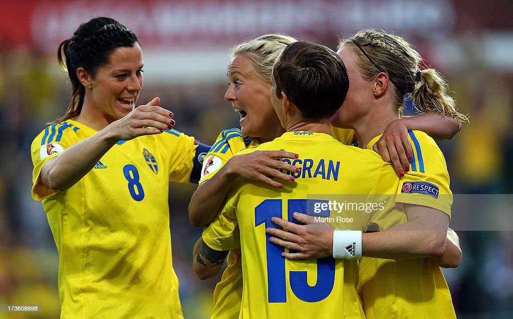 <a gi-track='captionPersonalityLinkClicked' href=/galleries/search?phrase=Lotta+Schelin&family=editorial&specificpeople=742197 ng-click='$event.stopPropagation()'>Lotta Schelin</a> #8 of Sweden celebrate with her team mates her team's opening goal the UEFA Women's Euro 2013 group A match between Sweden and Italy at Orjans Vall on July 16, 2013 in Halmstad, Sweden.