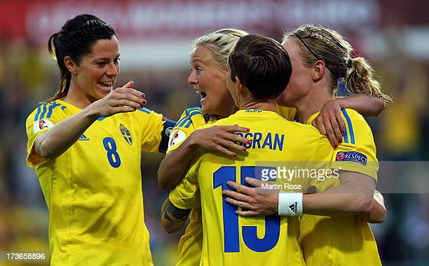 Lotta Schelin of Sweden celebrate with her team mates her team's opening goal the UEFA Women's Euro 2013 group A match between Sweden and Italy at...