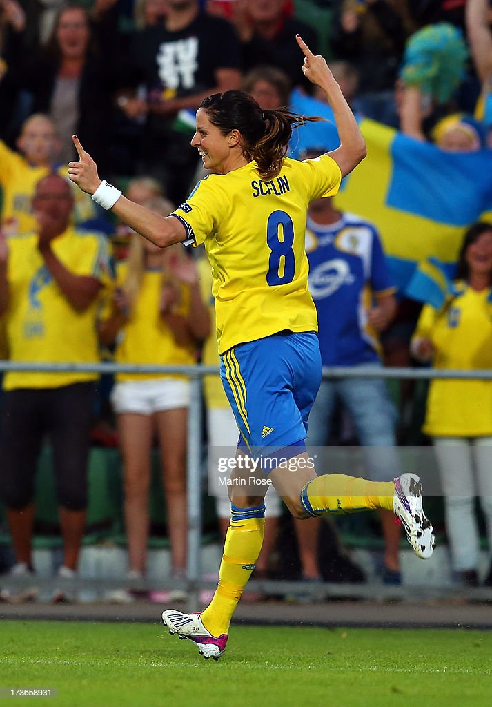 <a gi-track='captionPersonalityLinkClicked' href=/galleries/search?phrase=Lotta+Schelin&family=editorial&specificpeople=742197 ng-click='$event.stopPropagation()'>Lotta Schelin</a> #8 of Sweden celebrates after scoring her team's 2nd goal during the UEFA Women's Euro 2013 group A match between Sweden and Italy at Orjans Vall on July 16, 2013 in Halmstad, Sweden.