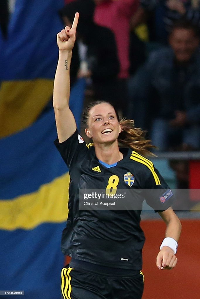 <a gi-track='captionPersonalityLinkClicked' href=/galleries/search?phrase=Lotta+Schelin&family=editorial&specificpeople=742197 ng-click='$event.stopPropagation()'>Lotta Schelin</a> of Sweden celebrates the forth goal during the UEFA Women's EURO 2013 Group A match between Finland and Sweden at Gamla Ullevi Stadium on July 13, 2013 in Gothenburg, Sweden.