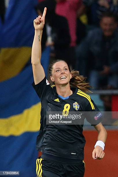 Lotta Schelin of Sweden celebrates the forth goal during the UEFA Women's EURO 2013 Group A match between Finland and Sweden at Gamla Ullevi Stadium...