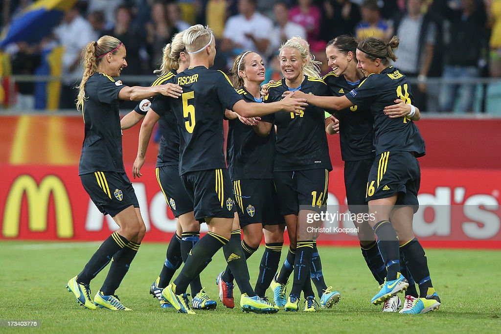 <a gi-track='captionPersonalityLinkClicked' href=/galleries/search?phrase=Lotta+Schelin&family=editorial&specificpeople=742197 ng-click='$event.stopPropagation()'>Lotta Schelin</a> of Sweden (2nd R) celebrates the forth goal with her team mates during the UEFA Women's EURO 2013 Group A match between Finland and Sweden at Gamla Ullevi Stadium on July 13, 2013 in Gothenburg, Sweden.