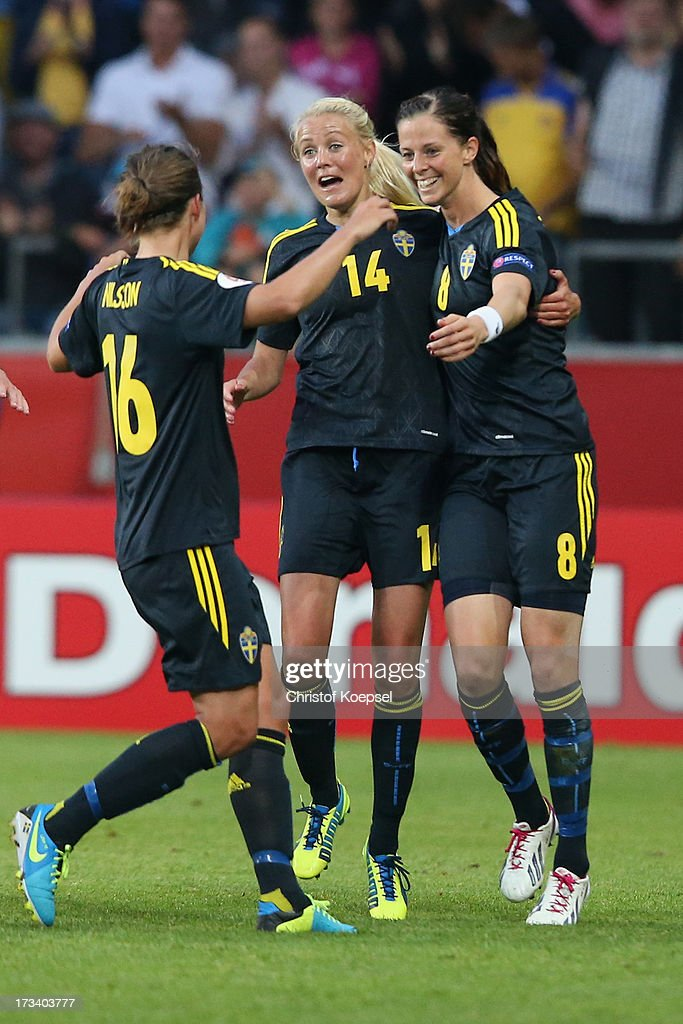 <a gi-track='captionPersonalityLinkClicked' href=/galleries/search?phrase=Lotta+Schelin&family=editorial&specificpeople=742197 ng-click='$event.stopPropagation()'>Lotta Schelin</a> of Sweden (R) celebrates the forth goal with <a gi-track='captionPersonalityLinkClicked' href=/galleries/search?phrase=Lina+Nilsson&family=editorial&specificpeople=754892 ng-click='$event.stopPropagation()'>Lina Nilsson</a> (L9 and Josefine Oeqvist (C) of Sweden during the UEFA Women's EURO 2013 Group A match between Finland and Sweden at Gamla Ullevi Stadium on July 13, 2013 in Gothenburg, Sweden.