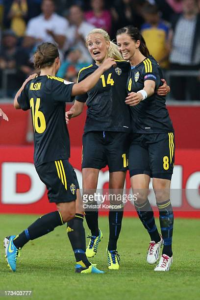 Lotta Schelin of Sweden celebrates the forth goal with Lina Nilsson L9 and Josefine Oeqvist of Sweden during the UEFA Women's EURO 2013 Group A match...