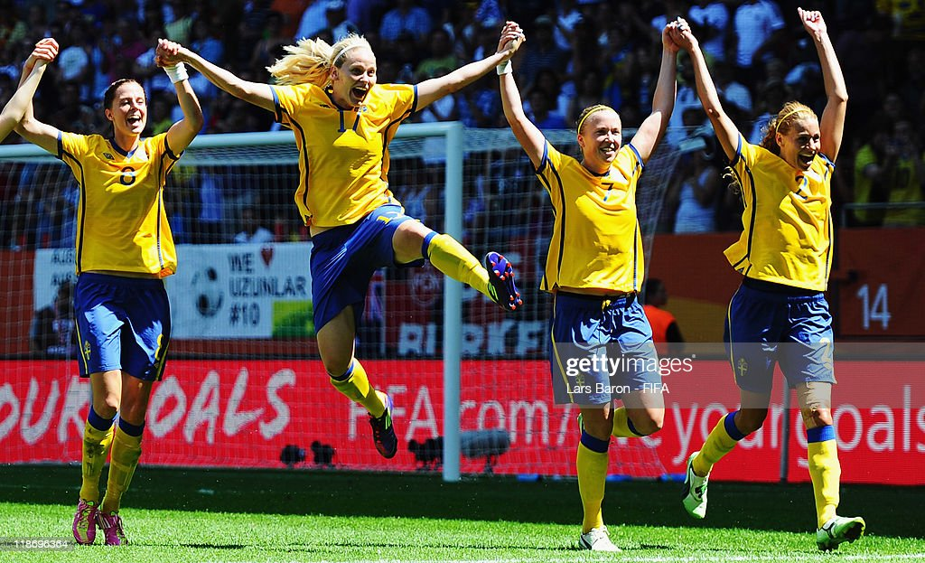 Lotta Schelin of Sweden celebrates with Lisa Dahlkvist, Sara Larsson and Charlotte Rohlin after winning the FIFA Women's World Cup 2011 Quarter Final match between Sweden and Australia at the FIFA Women's World Cup Stadium Augsburg on July 10, 2011 in Augsburg, Germany.